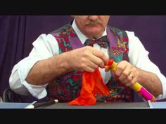 Magic Tricks - Three colored silks are placed one by one inside a clear tube. When removed, the silks are seen to have strangely knotted themselves together.    For affordable, easy-to-do, impressive Magic Tricks, visit: http://stores.ebay.com.au/CRAFT-MAGIC-AND-SURPRISES
