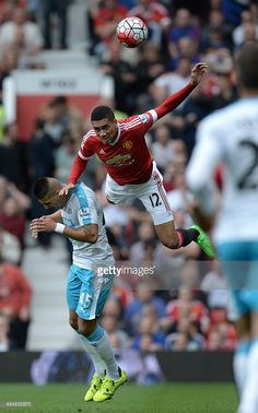 Newcastle United's Serbian striker Aleksandar Mitrovic (L) vies with Manchester United's English defender Chris Smalling