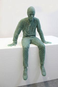 'seated glass figure', 2012  broken glass, resin. by Daniel Arsham