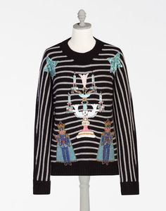 <i>The Fall-Winter 2016 collection recounts a dreamlike journey, suspended in a dimension lying between dreams and reality. The clothing and accessories evoke old memories, brought back to life with charming embroidery and appliqués, inspired by the fairy tales and toys of childhood.</i><br><br>Striped cashmere crewneck sweater:<br>• Wonderland-inspired jeweled appliqués and embroidery<br>• Gauge 5 knit<br>• Ribbed bottom<br>• Bust measures 56 cm from back neckline and wears an Italian size…