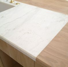 Calacatta marble around our kitchen island sink. #patinafarm
