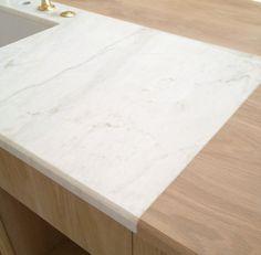 Calacatta marble around our kitchen island sink. #patinafarm