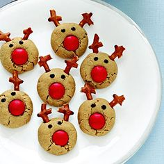Peanut Butter Rudolph Reindeer. Candy coated chocolate, pretzels, and chocolate chips turn these peanut butter cookies into Santa's reindeer. Kids love them!