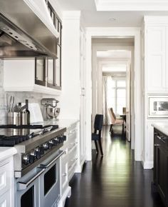 white galley kitchen, though I love the dark glossy floors : )