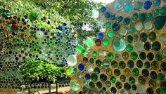 lots of glass bottle walls houses and art