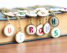 Personalized necklace in vintage style with hand embroidered initial. | Made on Hatch.co