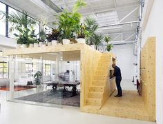 A garden is the roof of a meeting room in a loft office by jvantspijker