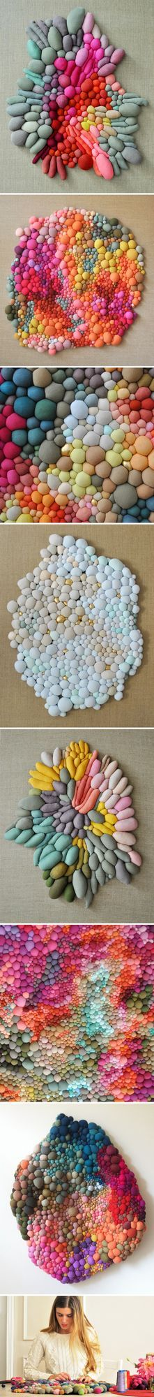 Gasp! So many colors, and oh so many little balls of hand-sewn goodness hanging on the wall! This is the organic/organized work of Chilean artist Serena Garcia Dalla Venezi. I can't decide if I want t