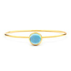 SYNA 18 karat yellow gold blue topaz large (approximately 7.50 cts) stacking bauble bracelet.  Available for purchase online at www.leonardojewelers.com and  in our Red Bank, NJ and Elizabeth, NJ stores.