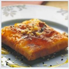 Feta cheese wrapped in Philo pastry and fried and toped with honey