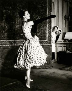 A 1950's Dior dress. I wish us women still dressed like this. Born in the wrong era I guess. :)