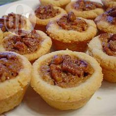 Tiny tart shells are fitted with rounds of prepared pastry. Then the sweet, buttery pecan filling is spooned in and the tarts baked until set. Pipe a whipped cream rosette onto each, and sprinkle with crushed pecans. Pecan Recipes, Tart Recipes, Dessert Recipes, Cooking Recipes, Sweet Recipes, Cupcakes, Croissants, Pecan Tarts, Pecan Pies