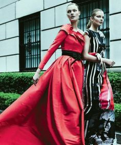 ladies walking wearing Carolina Herrera ballgowns