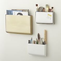 Shop revere wall mounted storage.   Slicked in sleek silver, gold or matte white, iron wall pocket collects mail in the entry, supplies and notes in the office and magazines in the living room.
