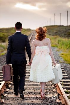 Really love this kind of wedding picture. So romantic. Walking in to the sunset together.