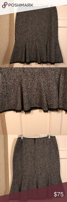 """Elie Tahari trumpet style reversible skirt Elie Tahari trumpet style reversible skirt. One side is a tweed of black and white. Other side is black. Wool skirt. Length is 25"""". Size 12. EUC. No damages excellent condition. No low offers. Price firm.   DISCLAIMER: You buy it, you keep it! If you are a habitual returner, do not buy from my closet. I am not responsible for you changing your mind about your purchase if you don't like what you received, or the size or color isn't right. Don't open…"""