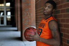 COLLEGE BASKETBALL: OSU's  Marcus Smart poses for photos at Oklahoma State University at Gallagher-Iba Arena in Stillwater,