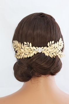 I have created this bold leafy Wedding Hair accessory which features vintage leaves which I have layered and soldered into a Stunning bold back