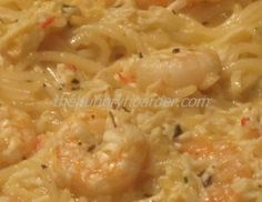 Seafood Spaghetti - This dish was amazing. Because it is adapted from a Paula Deen recipe it has plenty of butter, 3 sticks to be exact. A cross between a scampi and an alfredo sauce.