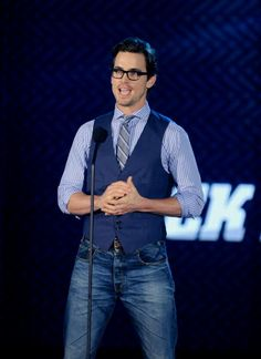 This looks is incredibly hot.  Love the vest/tie/Jean combo!