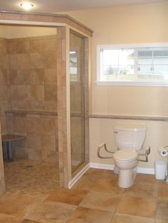 This no-threshold walk-in shower was designed for an individual with compromised mobility. Universal design principles were applied. There is a wide entry to the shower, a built-in shelf that accommodates the needs of the user and a shower seat.