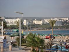Ayia Napa, Cyprus - View of beach front hotels and resorts Ayia Napa, Cyprus, Hotels And Resorts, Marina Bay Sands, Villa, Island, Heart, Building, Places