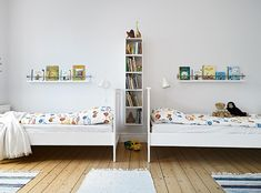 Love those shelves over the beds.