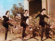 // Girls from the Iraqi National school of Music and Ballet practicing outside, Baghdad 1975.
