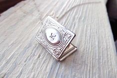 Personalized Locket Necklace Silver Book Locket with by IrinSkye, $19.00 My daughter would love this necklace.