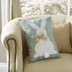 The aqua and tan chevron pattern mixed with the burlap bow makes this Easter Bunny Pillow perfect for any decor style!