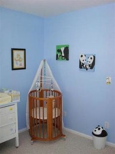 In the dog days of summer, this cool blue nursery is like a breath of fresh air. We saw Winston's nursery on Flickr, and found it so refreshing and cool looking that we couldn't resist posting it here. This nursery isn't just blue...it's also green - credenza, rocker, changing table and shelf all came from Craigslist, rather than being purchased new. Check out the rest of the photos, below: