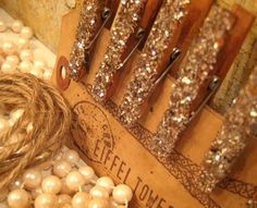 Neat idea: glitter-covered clothespins on twine. Great for displaying pictures.