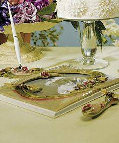Ornamental Dragonfly Wedding Guest Book features a poly resin cover in a pale green color.  The front cover has a picture window for you to add your favorite photo. This window is adorned with dragonflies, vines, flowers, and jewels that make a wonderfully unique design.