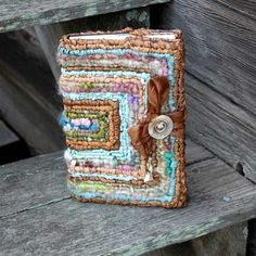 Journal Cover -  locker hooked like a rug!  A little ribbon and button closure makes this a durable chunky journal ready for action.