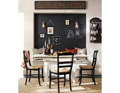 #potterybarn Chalkboard back wall of banquette black and white dining room