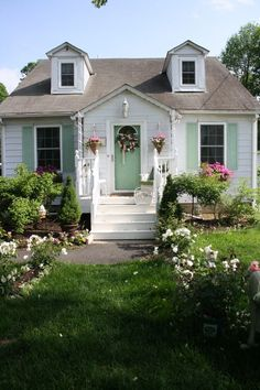 White Is A Common Exterior Paint Color For Small Cottages Like This