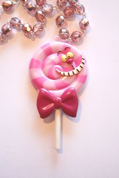 Cheshire Cat lollipop mirror necklace. inspiration for Alice in Wonderland party favours.