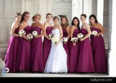 These girls wore plum and carried bouquets of mixed whites, creams and purples.  O'Connor wedding, photo by Bailly Photography.