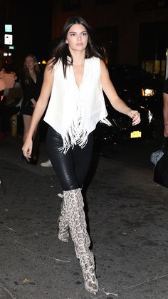 Kendall Jenner turned the sidewalk into her very own runway, rocking an amazing, fall-ready outfit, as she paired over-the-knee boots with tight leather pants and a fringe vest — how great is her NYC outfit?