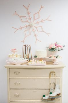 A Winter wonderland birthday celebration complete with ice skating and hot cocoa accents as well as a mint, blush, and mixed metals color palette.