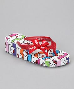 Take a look at this Rainbow Hello Kitty Bow Wedge Flip-Flops by Hello Kitty on #zulily today!