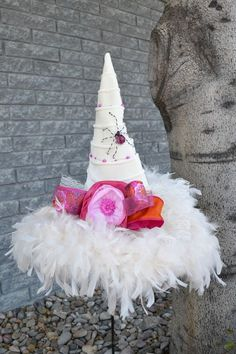 Hot and spirited is the look with this cream witch hat dressed in hot pink and orange accents. Cream Ridged Velvet 19 inch brim; 19 inch tall. Adjustable inner sizing band.