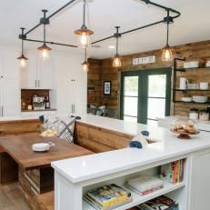 Room breakfast nook is built into the center island beneath custom natural wood country kitchen with built in dining room and industrial track lighting aloadofball Image collections