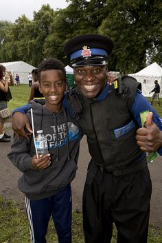 All smiles for a youngster and one of our police community support officers at the annual Manchester Caribbean.  The event took place recently and featured a host of attractions including live music, a fun fair and stalls selling a wide range of foods. The local Neighbourhood Policing team were on hand to meet the community. www.gmp.police.uk
