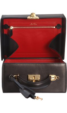 """Mark Cross Small Grace Trunk Bag.  Want this even more since I saw Grace Kelly use it, in """"Rear Window""""."""