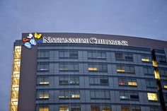 Even our hospital logo lights up at night! The windows reveal the headboard colors each patient has chosen