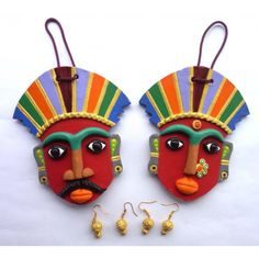 Beautiful terracotta masks as wall hangings Terracota Jewellery, Abstract Face Art, Wall Hanging Crafts, Puppet Crafts, Indian Folk Art, Indian Crafts, Leaf Crafts, Cardboard Art, Cute Clay