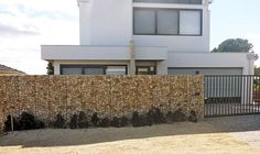 Rockweld fences and walls are a stylish alternative to traditional fencing. Made out of weld mesh and filled with rock they are strong, durable & cost effective