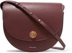 Mansur Gavriel's burgundy leather 'Saddle' bag is designed in a cool half-moon shape. Crafted in the Veneto region of Italy, it's punctuated with gold-tone hardware and has two spacious canvas-lined compartments. Adjust the shoulder strap to your desired drop.