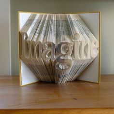 Folded book page sculpture